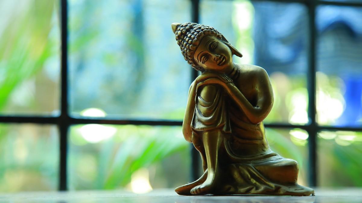Socha Buddhy je symbol pro buddhismus.